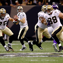 September 9, 2010; New Orleans, LA, USA;  New Orleans Saints quarterback Drew Brees (9) looks to pass during the NFL Kickoff season opener at the Louisiana Superdome. The New Orleans Saints defeated the Minnesota Vikings 14-9.  Mandatory Credit: Derick E. Hingle