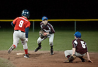 Laconia Savings Bank second baseman Brandon Lemay makes the out on Sea Dogs Dillan Sheffer then looks to first for the double play during the opening day night game for Gilford Cal Ripken versus the Franklin Sea Dogs.  (Karen Bobotas/for the Laconia Daily Sun)Gilford Cal Ripken opening day games May 7, 2011.