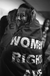 WOMEN'S RIGHTS cape on a packed train platform in the metro station after the Women's March on Washington, D.C.