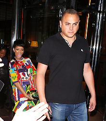 Singer Rihanna wearing a flag suit and carrying a Vivienne Westwood clutch bag with a gold penis on it, jokes around with the bag as she leaves her hotel in London, UK. 11/09/2013<br />BYLINE MUST READ : JAMESY/GOTCHA IMAGES<br /><br />Copyright by © Gotcha Images Ltd. All rights reserved.<br />Usage of this image is conditional upon the acceptance <br />of Gotcha Images Ltd, terms and conditions available at<br />www.gotchaimages.com