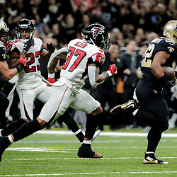 Dec 24, 2017; New Orleans, LA, USA; New Orleans Saints running back Mark Ingram (22) runs past Atlanta Falcons free safety Ricardo Allen (37) for a touchdown during the third quarter at the Mercedes-Benz Superdome. The Saints defeated the Falcons 23-13. Mandatory Credit: Derick E. Hingle-USA TODAY Sports