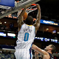 December 21, 2011; New Orleans, LA, USA; New Orleans Hornets small forward Al-Farouq Aminu (0) dunks over Memphis Grizzlies small forward Josh Davis (18) during the second half of a preseason game at the New Orleans Arena. The Hornets defeated the Grizzlies 95-80.  Mandatory Credit: Derick E. Hingle-US PRESSWIRE