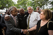 Rev. Al Sharpton meets  Judge Deborah Summey, wife of North Charleston Mayor Keith Summey following a peace vigil at the spot where unarmed motorist Walter Scott was gunned down by police April 12, 2015 in North Charleston, South Carolina. About 100 people showed up for the brief vigil following a healing service at Charity Mission Baptist Church.
