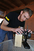 Brandon Lipjanic working on the controller that will allow manual or automatic operation of EMILY. The Emergency Integrated Lifesaving Lanyard, or EMILY, isn't fazed by stormy weather, cold water or rough surf. With a top speed of 22 mph, the remote-control rescue buoy can reach endangered swimmers up to six times faster than a human lifeguard and handle up to six people at a time, a feature that proved its worth when the robot aided in the 2015 rescue of 300 Syrian migrants near the Greek island of Lesbos.