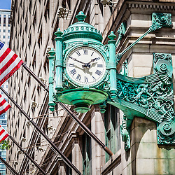 Chicago clock on Macy's (Marshall Field's) building store in downtown Chicago. The famous clock is one of Chicago's most recognizable symbols. Photo is high resolution.