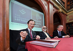 Christophe Blanchard-Dignac, 1st Vice President, The European Lotteries, left, European Disability Forum President Yannis Vardakastanis, center, and Friedrich Stickler, President of The European Lotteries, right, sign a cooperation agreement in Brussels, Belgium, on Wednesday, April 13, 2011. (Photo © Jock Fistick).