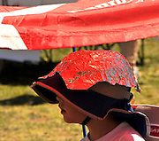 A young boy added recycled aluminum foil to his hat for protection at the Earth Day celebration at Reid Park, Tucson, Arizona, USA.