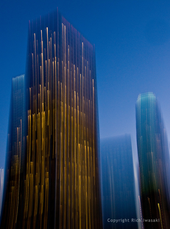 Blurred motion view of office buildings at night, Los Angeles, California
