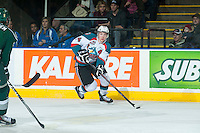 KELOWNA, CANADA - JANUARY 24: Rourke Chartier #14 of Kelowna Rockets skates along the boards with the puck against the Everett Silvertips on January 24, 2015 at Prospera Place in Kelowna, British Columbia, Canada.  (Photo by Marissa Baecker/Shoot the Breeze)  *** Local Caption *** Rourke Chartier;