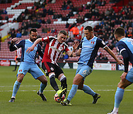 Caolan Lavery of Sheffield Utd tussles with Tom Parkes of Leyton Orient during the Emirates FA Cup Round One match at Bramall Lane Stadium, Sheffield. Picture date: November 6th, 2016. Pic Simon Bellis/Sportimage
