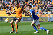 Wolverhampton Wanderers striker Bjorn Sigurdarson holds the ball away from Ipswich Town defender Jonas Knudsen during the Sky Bet Championship match between Wolverhampton Wanderers and Ipswich Town at Molineux, Wolverhampton, England on 2 April 2016. Photo by Alan Franklin.