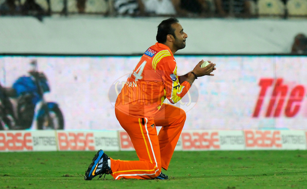 Adnan Rasool of Lahore Lions takes a catch to get the wicket of Andre Russell of Kolkata Knight Riders during match 7 of the Oppo Champions League Twenty20 between the Kolkata Knight Riders and the Lahore Lions held at the Rajiv Gandhi Cricket Stadium, Hyderabad, India on the 21st September 2014<br /> <br /> Photo by:  Pal Pillai / Sportzpics/ CLT20<br /> <br /> <br /> Image use is subject to the terms and conditions as laid out by the BCCI/ CLT20.  The terms and conditions can be downloaded here:<br /> <br /> http://sportzpics.photoshelter.com/gallery/CLT20-Image-Terms-and-Conditions-2014/G0000IfNJn535VPU/C0000QhhKadWcjYs