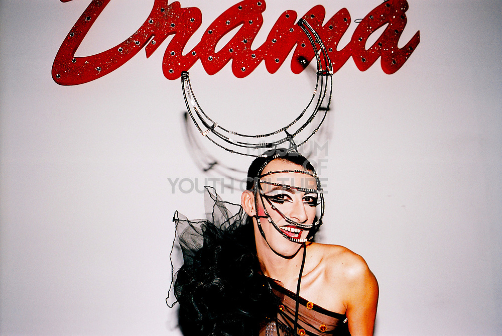 A Transvestite with a fancy headdress poses at Return to Narnia, Pushca, New Years Eve, 2004