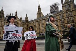 © Licensed to London News Pictures. 07/09/2017. London, UK. Protestors dressed as King Henry VIII hold banners outside the Houses of Parliament in London as parliament debates the EU Withdrawal Bill. A vote will take place in parliament early next week to decide of EU laws will be enshrined in UK law as part of Brexit. Critics of the bill have said it will let government ministers grab powers from parliament. Photo credit: Ben Cawthra/LNP