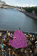 France. Paris 5th district. Archeveche bridge.  love locks  on the  seine river  beetween left bank and ile de la cite  / cadenas d amour sur le pont de l archeveche sur la seine entre l ile de la cite et la rive gauche