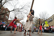 Actor Juan Ponce, 27 portrays Jesus Christ during a Good Friday Via Crucis in Chicago's Rogers Park neighborhood. The religious portrayal recounts the biblical steps of Jesus Christ being condemned to death, followed by his crucifixion and entombment.