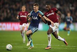 Tottenham Hotspur's Juan Foyth (left) and West Ham United's Michail Antonio battle for the ball