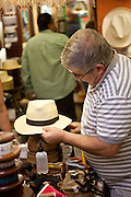 A hat maker blocks a Panama hat in Old San Juan, Puerto Rico