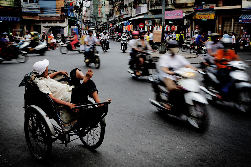 Ho chi Minh, (Saigon) The traditional rickshaws are crowed out to the jobs because the heavy motorisation is prevalent.