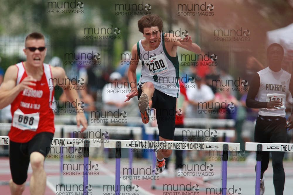 (London, Ontario}---05 June 2010) Zack Hildebrand of Westlane - Niagara Falls  competes in the 300m / 400m hurdle finals at the 2010 OFSAA Ontario High School Track and Field Championships in London, Ontario,  June 05, 2010. Photograph copyright Dave Chidley / Mundo Sport Images, 2010.