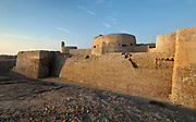 Spur Tower, which protected the keep or Captain's Tower, and to either side, Genoan style bastions, built 1561 AD, at Qal'at al-Bahrain, or Bahrain Fort or Portuguese Fort, built 6th century AD, once the capital of the Dilmun Civilisation, near Manama in Bahrain. The site consists of a tell or artificial mound 12m high containing 7 layers of archaeological remains dating from 2300 BC to the 18th century, topped with a medieval fortress. There is evidence of Kassites, Greeks, Portuguese and Persians, with burial sites, fortifications and residential areas. Qal'at al-Bahrain is listed as a UNESCO World Heritage Site. Picture by Manuel Cohen