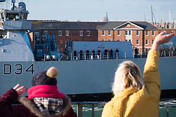 © Licensed to London News Pictures. 01/12/2017. Portsmouth, UK.  People gather to welcome the troubled Royal Navy Type-45 Destroyer, HMS Diamond, as she returns to Portsmouth following 'technical issues'. The £1 billion Daring-class warship has returned home early from her patrol on Operation Kipion in the Gulf. Photo credit: Rob Arnold/LNP