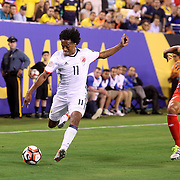 EAST RUTHERFORD, NEW JERSEY - JUNE 17: Juan Cuadrado #11 of Colombia is challenged by Alberto Rodriguez #2 of Peru during the Colombia Vs Peru Quarterfinal match of the Copa America Centenario USA 2016 Tournament at MetLife Stadium on June 17, 2016 in East Rutherford, New Jersey. (Photo by Tim Clayton/Corbis via Getty Images)