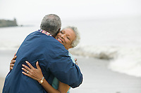 Middle-aged couple embracing at beach