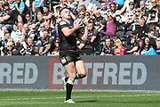 Hull FC centre Jack Logan (24) catches a high ball during the Betfred Super League match between Hull FC and Hull Kingston Rovers at Kingston Communications Stadium, Hull, United Kingdom on 19 April 2019.