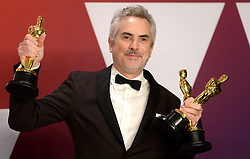 "Alfonso Cuaron, winner of the Best Director Award, Best Foreign Film Award and Best Cinematography Award for ""Roma"" at the 91st Annual Academy Awards (Oscars) presented by the Academy of Motion Picture Arts and Sciences.<br /> (Hollywood, CA, USA)"