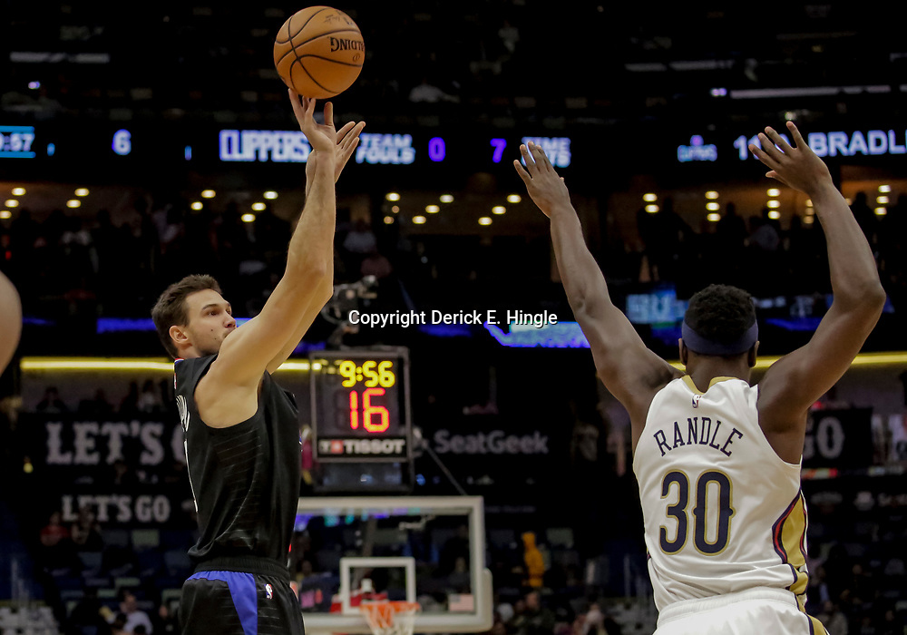 Dec 3, 2018; New Orleans, LA, USA; LA Clippers forward Danilo Gallinari (8) shoots oer New Orleans Pelicans forward Julius Randle (30) during the first quarter at the Smoothie King Center. Mandatory Credit: Derick E. Hingle-USA TODAY Sports