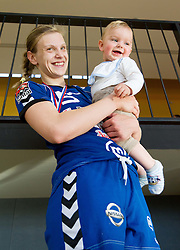 Barbara Varlec Lazovic with her son Luka after the last game of 1st A Slovenian Women Handball League season 2011/12 between ZRK Krka and RK Krim Mercator, on May 8, 2012 in Stopice at Novo mesto, Slovenia. RK Krim Mercator became Slovenian National Champion, GEN-I Zagorje placed second and ZRK Krka placed third. (Photo by Vid Ponikvar / Sportida.com)