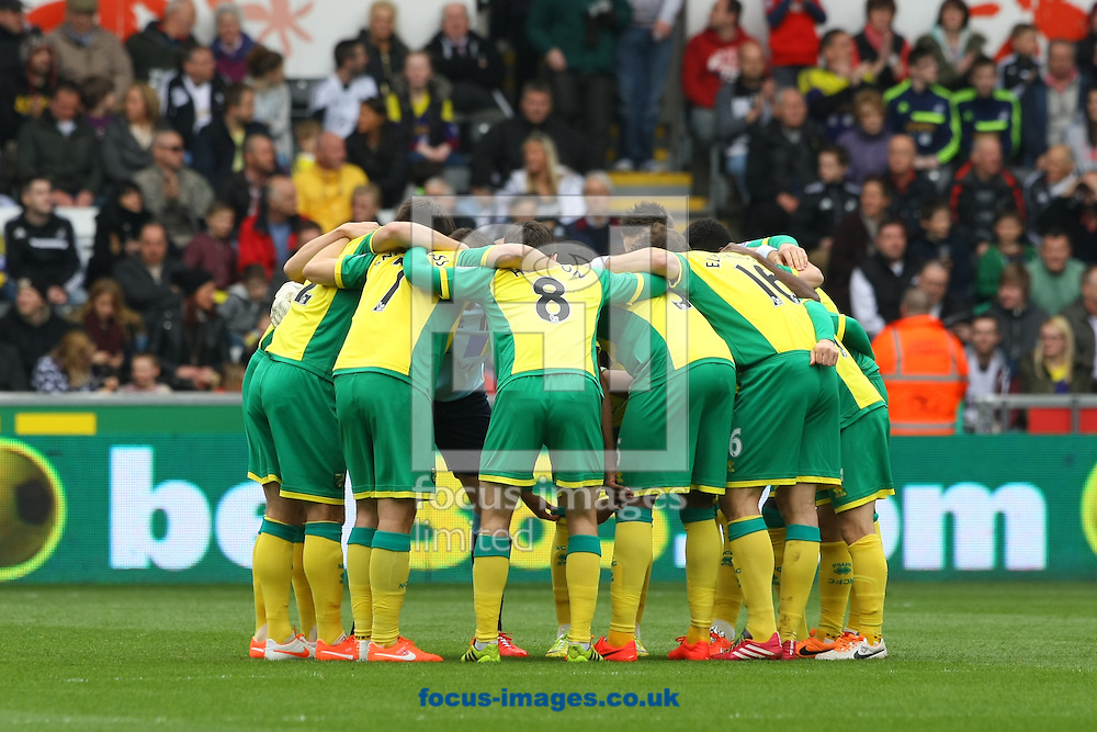 Norwich players in the pre match huddle before the Barclays Premier League match at the Liberty Stadium, Swansea<br /> Picture by Paul Chesterton/Focus Images Ltd +44 7904 640267<br /> 29/03/2014