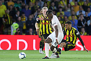 Manchester United Midfielder Paul Pogba is tackled Watford midfielder Etienne Capoue (29) during the Premier League match between Watford and Manchester United at Vicarage Road, Watford, England on 15 September 2018.