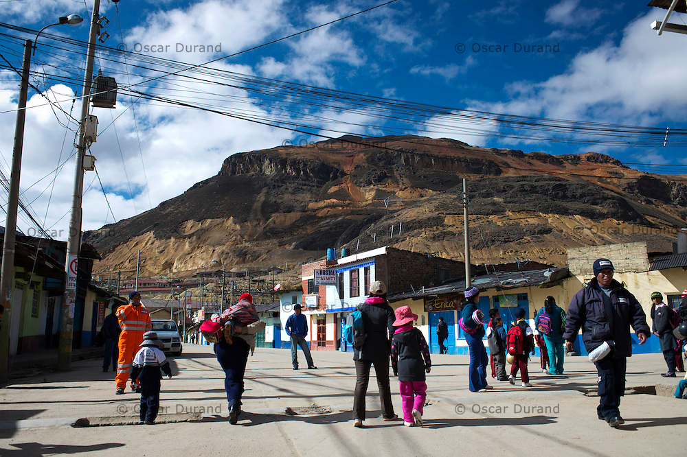 Early morning rush hour in the town of Morococha, located in the central Peruvian Andes. Chinese mining company Chinalco has plans to build an open pit mine in the area and hopes to relocate all the residents of this town. Pictured in the back is Mount Toromocho, which holds a large polymetallic deposit.