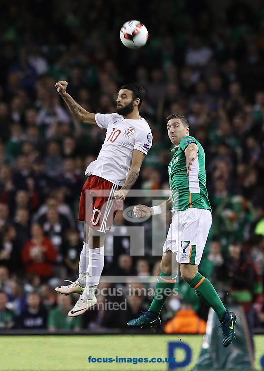 Stephen Ward of Republic of Ireland and Tornike Okriashvili of Georgia during the 2018 FIFA World Cup Qualifying match at the Aviva Stadium, Dublin<br /> Picture by Lorraine O'Sullivan/Focus Images Ltd +353 872341584<br /> 06/10/2016