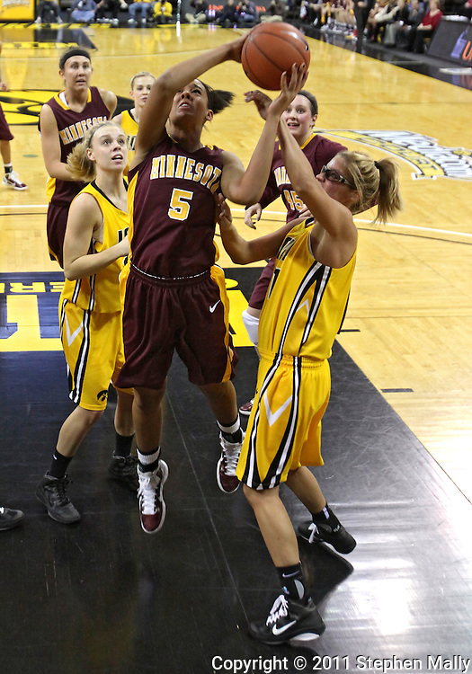 February 10 2011: Minnesota Golden Gophers forward Kionna Kellogg (5) puts up a shot as Iowa Hawkeyes guard/forward Hannah Draxten (31) defends during the first half of an NCAA women's college basketball game at Carver-Hawkeye Arena in Iowa City, Iowa on February 10, 2011. Iowa defeated Minnesota 64-62.