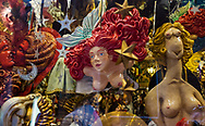 Colorful and provocative masks fill a shop window in Venice, Italy