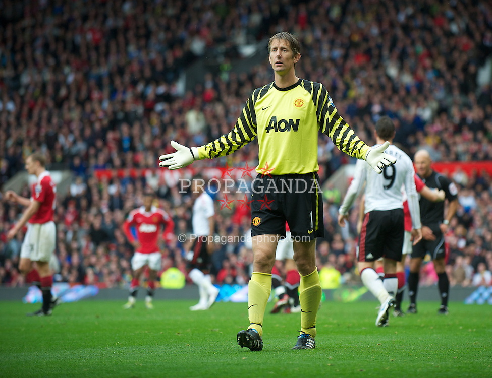 MANCHESTER, ENGLAND - Sunday, September 19, 2010: Manchester United's goalkeeper Edwin van der Sar appeals to the linesman after a penalty was awarded against his side, despite the fact it was a blatant foul, the Manchester United player just cannot accept the referee's decision during the Premiership match at Old Trafford. (Photo by David Rawcliffe/Propaganda)
