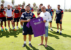 A Bristol City fan is presented with a shirt by Bristol City head coach Lee Johnson on his Birthday during the open training session - Mandatory by-line: Matt McNulty/JMP - 20/07/2017 - FOOTBALL - Tenerife Top Training Centre - Costa Adeje, Tenerife - Pre-Season Training