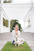 Chelsea and her Dogs sit on the grass under the gazebo at Chase Park, Marina Del Rey, California