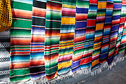 Colourful blankets hanging in street at Ajijic, Jalisco, Mexico.