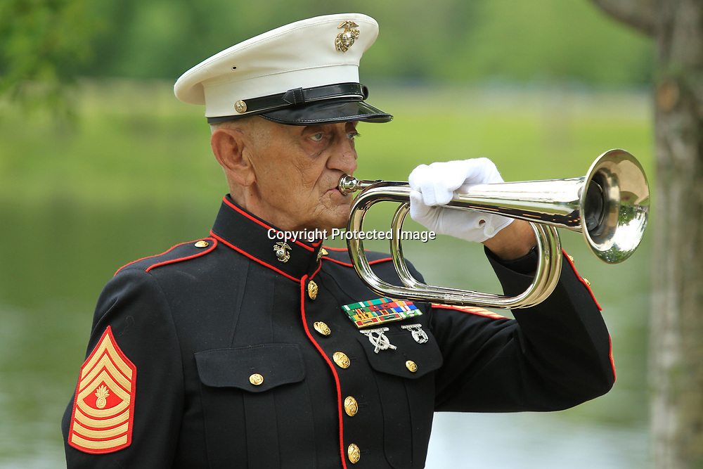 MGySgt Bob Verell, US Marine Corps Retired, plays taps at the conclusion of Tupelo's Memorial Day Service held at Veterans Park Monday morning.
