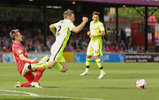 James Berrett fouls Carl Magnay during the Sky Bet League 2 match between York City and Hartlepool United at Bootham Crescent, York, England on 15 August 2015. Photo by Simon Davies.