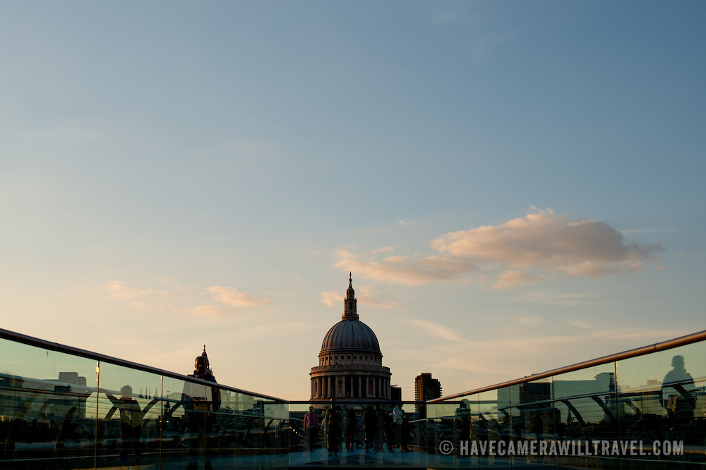 A silhouette of St Paul's Cathedral, one of the most distinctive of London's landmarks. In the foreground is part of Millenium Bridge on the other side of the River Thames.