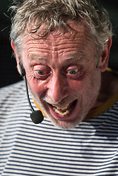Image ©Licensed to i-Images Picture Agency . 20/07/2014 . Henham Park , Suffolk , United Kingdom . Poet and novelist MICHAEL ROSEN talks in the Poetry Arena . The Latitude Festival of music and arts . Picture by Joel Goodman/i-Images