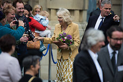 © Licensed to London News Pictures . 14/05/2015 . Liverpool , UK . THE DUCHESS OF CORNWALL talks to the crowd as she leaves . The Prince or Wales and the Duchess of Cornwall visit the World Museum in Liverpool . Photo credit : Joel Goodman/LNP