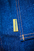 The HMP Prison tag on pair of prison issued jeans. <br /> HMP/YOI Portland, a resettlement prison with a capacity for 530 prisoners. Dorset, United Kingdom.