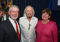 (L-R) Brian McLaughlin, Barry Gibb, Sue McLaughlin. The Silver Clef Lunch 2013 in aid of  Nordoff Robbins held at the London Hilton, Park Lane, London.<br /> Friday, June 28, 2013 (Photo/John Marshall JME)