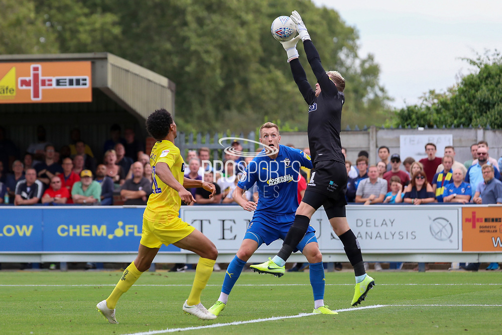 Wycombe Wanderers goalkeeper Ryan Allsop (1) saving cross with AFC Wimbledon striker Joe Pigott (39)waiting during the EFL Sky Bet League 1 match between AFC Wimbledon and Wycombe Wanderers at the Cherry Red Records Stadium, Kingston, England on 31 August 2019.